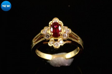 18ky padparadscha sapphire and diamond ring