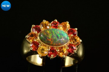 18kyg black opal and colored sapphire ring