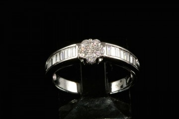 14kwg baguette and round diamond ring.  Orig. $1500.00