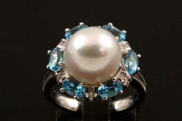 18kwg South Sea pearl, diamond, and blue topaz ring