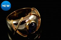 18k two tone cabochon sapphire band style ring
