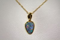10k plated opal pendant